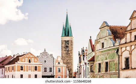 Church of the Holy Spirit and famous 16th-century houses in Telc, Czech republic. Architectural scene. Unesco World Heritage Site. Beauty photo filter.
