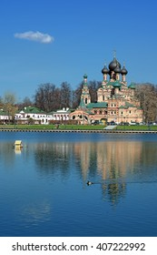 Church of the Holy Trinity reflecting on the water of Ostankino pond in Moscow