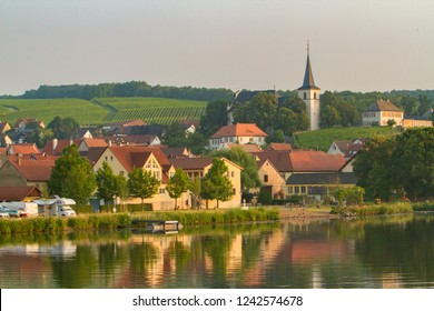 Church and homes along the Main-Danube Canal, Schweinfurt, Germany