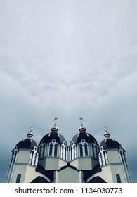 Church. Ideal symmetry