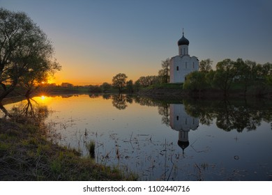 Church of Intercession of Holy Virgin on Nerl River. Ancient white-stone temple with reflection in the water, Bogolyubovo, Russia