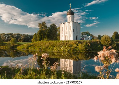 Church of the Intercession of the Mother of God on the Nerl. Ancient Russian Church shot in summer evening, at sunset.
