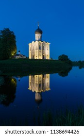 The Church of the Intercession on the Nerl summer night with reflection in the water
