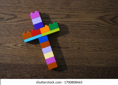 Church for kid concept, Bible Study for child, Colorful Christian cross made of bricks toys on wooden table.