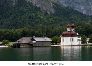 Church at Lake in Front of Mountain