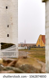 Church and lighthouse on a hazy April day, Denmark