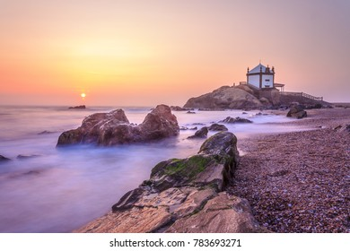 Church Lord of the Stone in Porto, Portugal by sunset