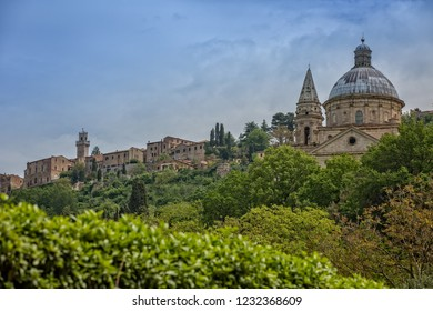Church of the Madonna di San Biagio at the gates of Montepulciano. View of the church Madonna di San Biagio and of the hilltop town of Montepulciano in Tuscany, Italy