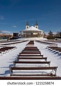 Church in Medjugorje, shot during big snow, with benches