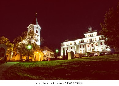 Church of Mother God and Missionary museum, Calvary in Nitra city, Slovak republic. Night scene. Religious architecture. Red photo filter.