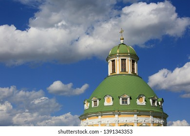 Church of the Nativity of the Blessed Virgin in Podmoklovo, Moscow Region, Russia. The dome of the temple against the sky and clouds