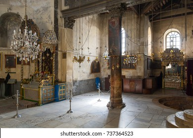 Church of the Nativity interior with icon-lamps hanging on long chains. Bethlehem.