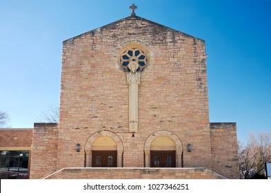 church nave exterior and double door entrances in west saint paul minnesota