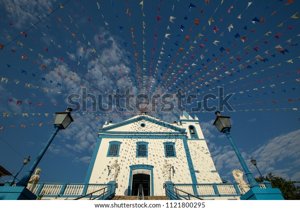 Church Nossa Senhora Dajuda, in Ilha Bela, north coast of Sao Paulo, Brazil, adorned with flags typical of the June Festivals.