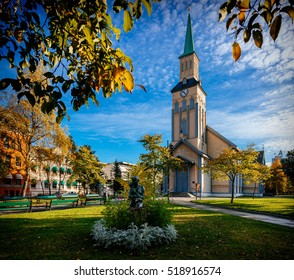 Church in October morning light in Tromso, Norway, with a mother and child statue