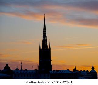 A church on colourful sunrise background