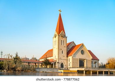 A church on the edge of a river in Qingdao