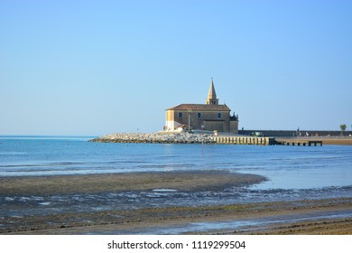 The church on the sea of Caorle, on the Adriatic Sea in Italy