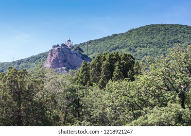 Church on the top of the rock. Russia, Republic of Crimea. 12.06.2018: Foros Church of the Resurrection of Christ (1892) stands on the top of the Red Rock (400m)