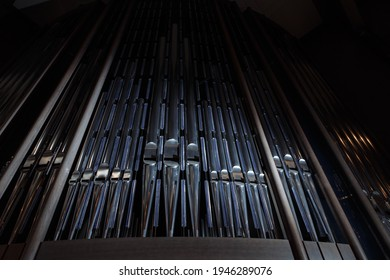 Church organ with many metal pipes - Shutterstock ID 1946289076