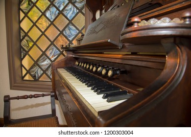Church organ and stained windows.