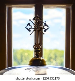 Church orthodox cross opposite window landscape sun rays blue sky green grass. Concept of Orthodoxy religion education enlightenment for protection of peaceful life of the clergy