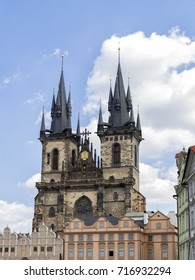 The Church of Our Lady before Tyn dominates the Via Musica and the Gallery of Art buildings in front of it in Prague, Czech Republic.
