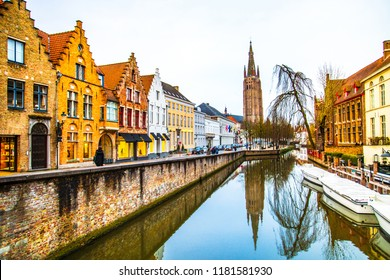 The Church of Our Lady (Onze-Lieve-Vrouwekerk) and Dijver canal in the old town of Bruges (Brugge), Belgium
