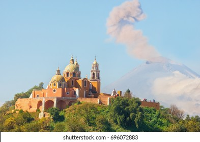 Church of Our Lady of Remedies in Cholula with Popocatepetl Volcano , Mexico