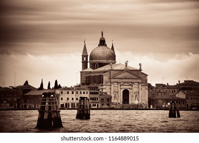 Church over sea with dome in Venice Italy.
