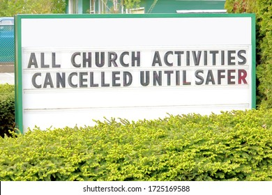 A church posts an important message during the Covid 19 pandemic on a large sign in front of the building.