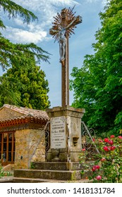 Church of Rennes le Chateau, France. Detail of the Statue of Cross, and Jesus Christus