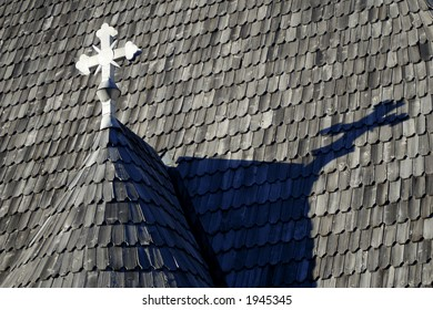 church roof with white cross
