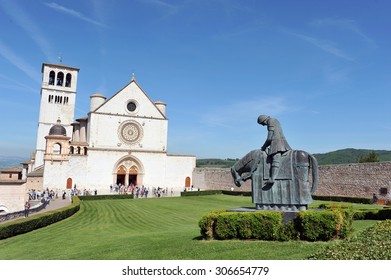 Church of Saint Francis in Assisi, Italy with blue skies in the back.