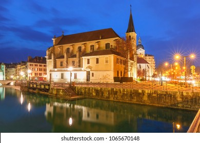 Church of Saint Francois de Sales and Thiou river during morning blue hour in old city of Annecy, Venice of the Alps, France