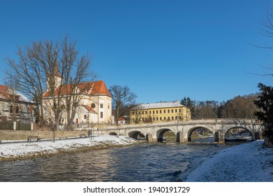 Church of Saint John the Baptist with river Oslava and the baroque bridge, Namest nad Oslavou, Czech Republic - Shutterstock ID 1940191729