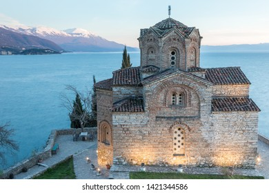 The Church of Saint John the Theologian, overlooking the blue waters of Lake Ohrid at twilight in the Republic of North Macedonia.
