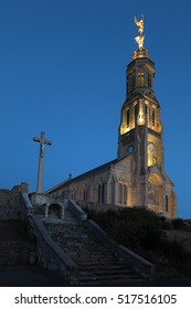 Church of Saint Michael in Saint-Michel-Mont-Mercure, France with a large figure of the Archangel Michael at the top of the tower