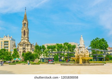 Church of Sainte Perpetue and fountain Pradier in Nimes, France