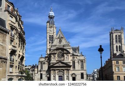 Church of Saint-Etienne du Mont against a blue sky in Paris, France