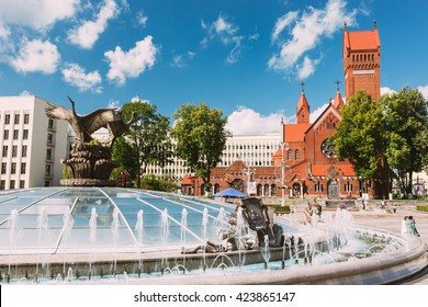 Church Of Saints Simon And Helen or Red Church And Fountain At Independence Square In Minsk, Belarus