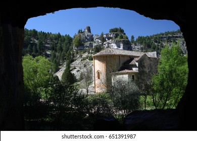 Church of San Batolomé from the interior of the prehistoric cave, Canyon of the Wolves River, Soria, Spain, romanesque