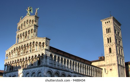 The church of San Michele in Foro of Lucca is a basilica with three aisles, transept and semicircular apse; the nave is supported by arches resting upon monolithic pillars.