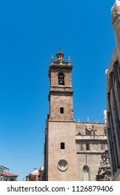 Church of Sant Joan del Mercat bell tower against blue sky. Valencia, Spain.