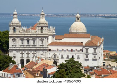 Church of Santa Engracia, Lisbon, Portugal with the ocean in the background