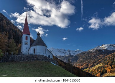 The church of Santa Gertrude in the Ultental valley in an autumnal landscape