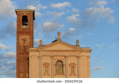 church of santa maria assunta with bell tower in the autumn evening sun in Gallarate, Varese, Italy