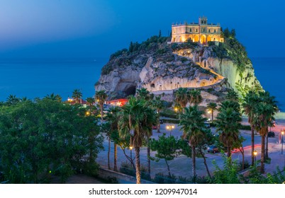Church of Santa Maria dell'Isola located on the cliff near the town of Tropea, Italy after sunset