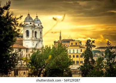 The church of the Santissima Trinita dei Monti and Spanish Steps on a sunrise. Rome. Italy
