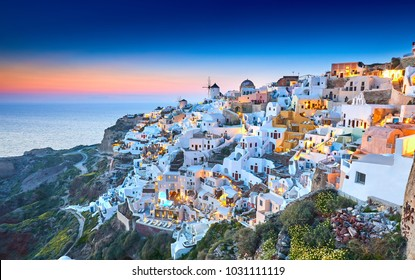Church of Santorini. Fira town on Santorini island, Greece. Incredibly romantic sunset on Santorini. Oia village in the morning light. Amazing sunset view with white houses. Island lovers